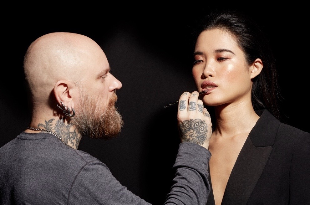 Pablo Rodriguez applying makeup on a model